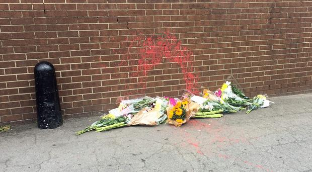 Flowers left at the scene where a homeless man was sprayed with paint in Normanby (Tom Wilkinson/PA)