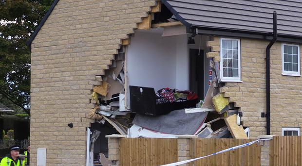The house was severely damaged (Dave Higgens/PA)