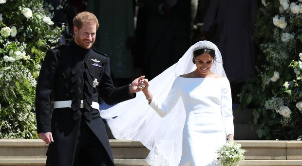 The Duchess of Sussex, pictured on the day she married, will talk about her wedding gown in a new documentary (Jane Barlow/PA)