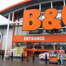 BandQ owner Kingfisher has seen half-year profits tumble after being hit by woes in its French arm and amid consumer belt tightening in the UK.