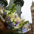 Flowers left on Westminster Bridge following the terror attack (Lauren Hurley/PA)
