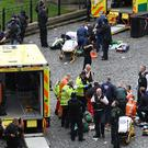 Emergency services at the scene outside the Palace of Westminster (Stefan Rousseau/PA)