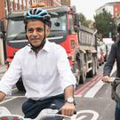 Mayor of London Sadiq Khan, left, and the city's walking and cycling commissioner Will Norman open a major new extension to London's Cycle Superhighway 6 (Stefan Rousseau/PA)