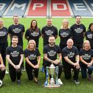 James McFadden, centre, with Diageo representatives at Hampden (DrinkPositive/PA)