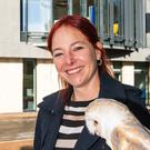 Alice Roberts poses with an owl during her visit to the Milner Centre for Evolution (University of Bath/PA)