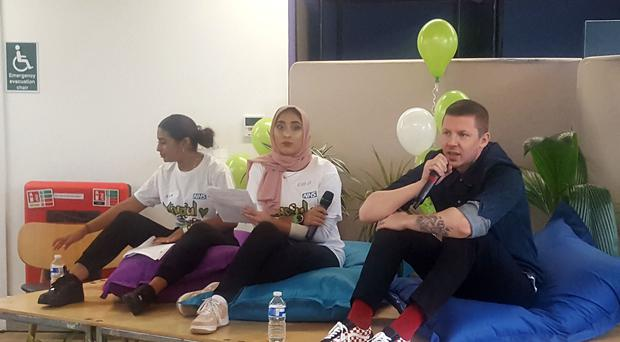 Professor Green speaks with teenagers affected by the Grenfell tragedy (Helen William/PA)
