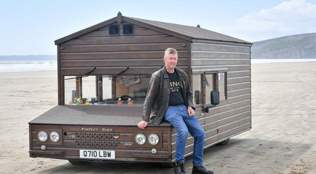 Kevin Nicks, the creator and driver of the Fastest Shed (Ben Birchall/PA)