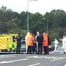 The scene on the A369 in Portishead, near Bristol, after police received a report of a man pointing a gun at another motorist on the M5 (Claire Hayhurst/PA)