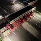 A section of bridge is removed from above the M6 in Staffordshire (Highways England/PA)