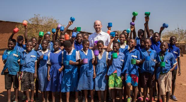 Ben Macpherson with children at the school in Malawi (Mary's Meals/PA)