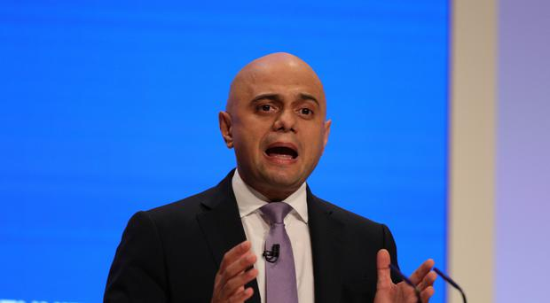 Sajid Javid's father arrived in Britain in the 1960s from Pakistan (Aaron Chown/PA)