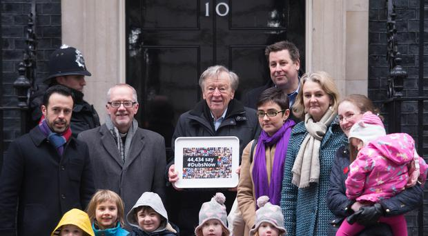 Labour peer Lord Dubs accompanied by religious and community leaders and foster carers hands in a petition calling on the Prime Minister to reconsider the decision to close the Dubs scheme for vulnerable unaccompanied refugee children in Europe (Stefan Rousseau/PA)