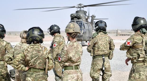 Medical crews discuss the movement of casualties into a Puma helicopter as part of Saif Sareea 3 (Ben Birchall)