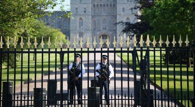 Police officers are seen at Windsor Castle (Jeff J Mitchell/PA)