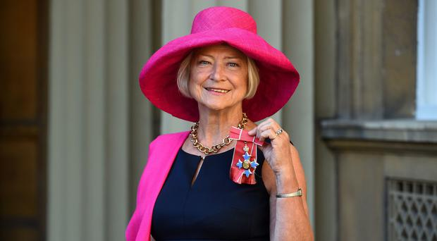 Kate Adie holding her CBE medal for services to media following an Investiture ceremony at Buckingham Palace, London (Kirsty O'Connor/PA)