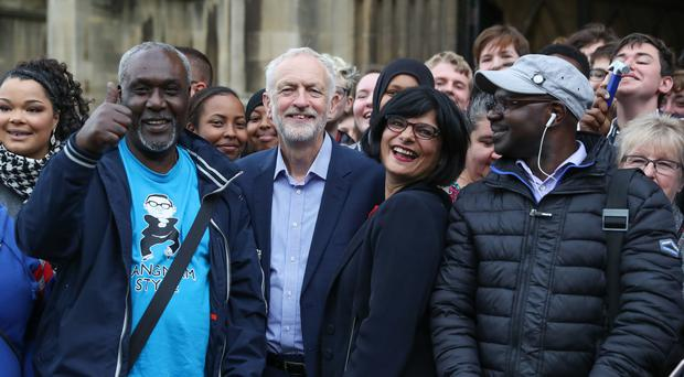 Labour party leader Jeremy Corbyn (2nd left) and Thangam Debbonaire, Labour MP for Bristol West (2nd right) pose for a photograph with members of the public, during his visit to the Alone with Empire exhibition at City Hall in Bristol (Andrew Matthews/PA)