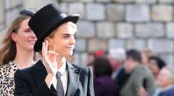 Cara Delevingne wore top hat and tails (Gareth Fuller/PA