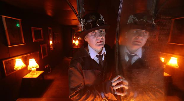 Scott Meiklejohn as the Mad Hatter inside one of the fright rooms at Blair Drummond Safari Park (Andrew Milligan/PA)