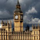 Dark clouds over the Houses of Parliament in Central London (PA)