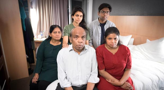 Sangarapillai Balachandran, 60, with his wife Shanthy (left), son Pranavan and daughters Karthika and Sinthuja are facing deportation from the UK (Stefan Rousseu/PA)