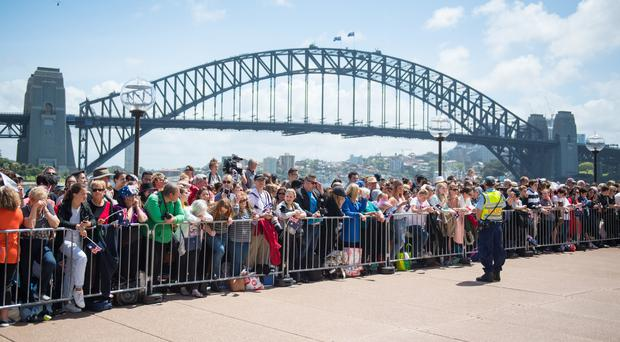 Members of the public await the arrival of the Duke and Duchess of Sussex outside the Sydney Opera House (Dominic Lipinski/PA)
