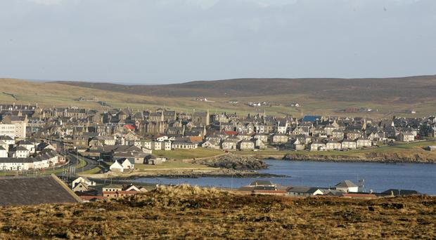 A general view of the town of Lerwick on the Shetland island after plans were announced to build the world's largest community wind farm on Shetland, capable of generating enough power to supply a quarter of Scotland's homes. The islands council, which has already made a fortune from its oil fund established 20 years ago, is now poised to make a massive windfall from renewable energy. The £600-million development of 200 turbines is to be built across a 90sq-km site on the north of the Shetland mainland.The winds on Shetland are expected to keep the turbines turning at full power 50 per cent of the time – compared with the average load factor on the mainland of between 30 and 35 per cent.