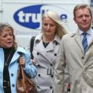 Conservative MP Craig Mackinlay, with his wife Kati Mackinlay (second left), arrive at Southwark Crown Court (Jonathan Brady/PA)