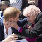 The Duke of Sussex meets 98-year-old Daphne Dunne during a walkabout outside the Sydney Opera House on the first day of the Royal couple's visit to Australia. (Paul Edwards/The Sun/PA)