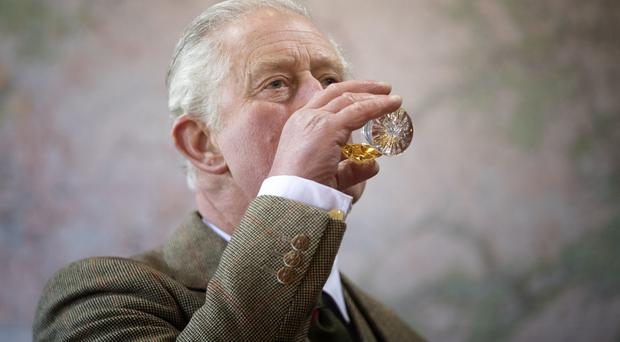 The Prince of Wales, known as the Duke of Rothesay while in Scotland, takes part in a whisky tasting during a visit to the Royal Lochnagar Distillery at Crathie on Royal Deeside.