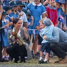 The Duke and Duchess of Sussex are greeted by schoolchildren as they arrive at Dubbo City Regional Airport (Dominic Lipinski/PA)