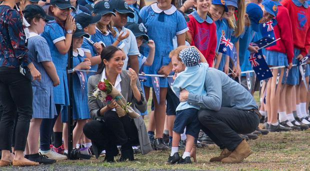 Five-year-old steals the show with hug from Harry as royal couple
