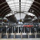 The gates at Paddington Station are quiet amid severe disruption (Yui Mok/PA)