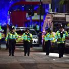 File photo dated 03/06/17 of police officers on Borough High Street, where a terrorist attack took place (Dominic Lipinski/PA)