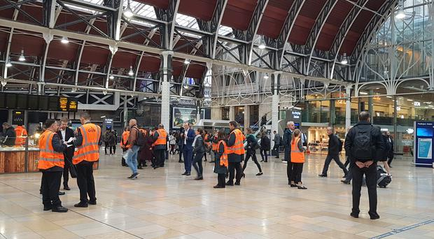 The scene at Paddington station (Tess De La Mare/PA)