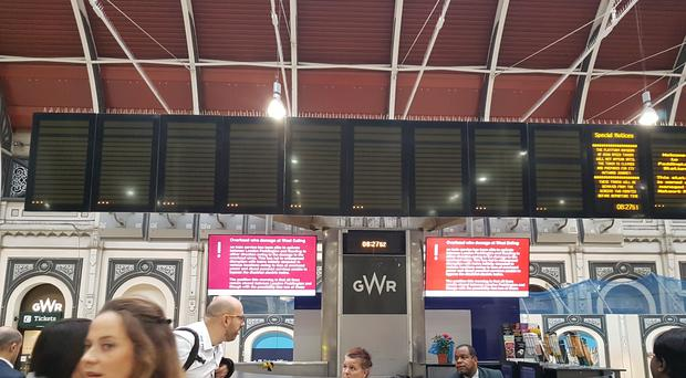 An empty departure board at Paddington Station (Tess De La Mare/PA)