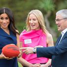The Duchess of Sussex tried her hand at Aussie Rules football during a visit to Melbourne (Dominic Lipinski/PA)