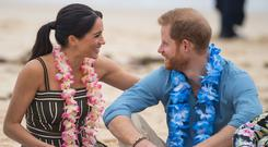The Duke and Duchess of Sussex were affectionate during a visit to Bondi Beach (Dominic Lipinski/PA)