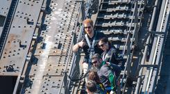 The Duke of Sussex gives a thumbs up as he climbs Sydney Harbour Bridge (Dominic Lipinski/PA)