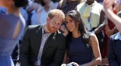 The Duke and Duchess of Sussex watch a performance during their visit to Macarthur Girls High School in Sydney (Phil Noble/PA)