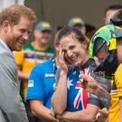 The Duke of Sussex laughs as athlete Benjamin Yeomans puts a pair of swimming trunks on his head (Dominic Lipinski/PA)