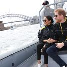 The Duke and Duchess of Sussex watch competitors taking part in a sailing event at the 2018 Invictus Games in Sydney harbour (Chris Jackson/Invictus Games Foundation/PA)