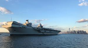 The UK's new aircraft carrier HMS Queen Elizabeth at anchor two miles from Manhattan during its visit to New York City (Georgina Stubbs/PA)