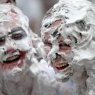 The traditional foam fight takes place at St Andrews University each year (Jane Barlow/PA)