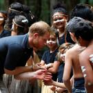 The Duke of Sussex greets a member of the Butchulla People (Phil Noble/PA)