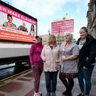 Glasgow City Council workers help to launch a giant new poster in a plea for solidarity in George Square, Glasgow, ahead of the equal pay strike (Jane Barlow/PA)