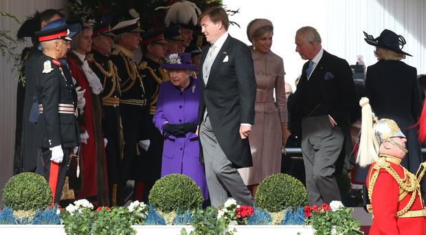 Queen Elizabeth II and the Prince of Wales (second right) walk with King Willem-Alexander and Queen Maxima of the Netherlands at Horse Guards Parade, London, during the ceremonial welcome at the start of the Dutch state visit to the UK.
