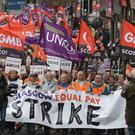 Strikers march to Glasgow City Chambers for a mass rally during a 48-hour strike over equal pay (Andrew Milligan/PA)