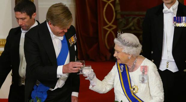 The Queen makes a toast during the State Banquet (Yui Mok/PA)