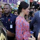 The Duchess of Sussex is escorted through Suva Market (Kirsty Wigglesworth/PA)