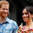 The Duke and Duchess of Sussex donned brightly-coloured outfits in Fiji (Phil Noble/PA)